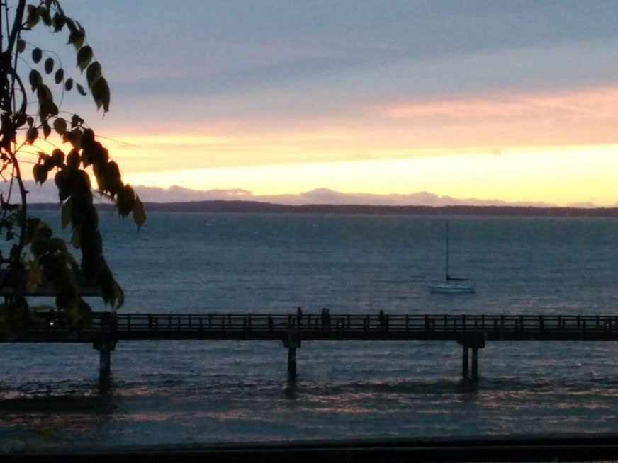 Bellingham Bay with yellow, orange, pink and blue sunset over islands.