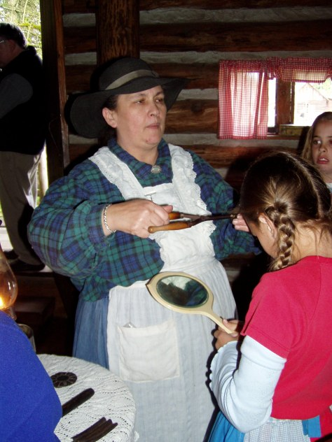 students at pioneer cabin learning about curling iron that you heat in a fire