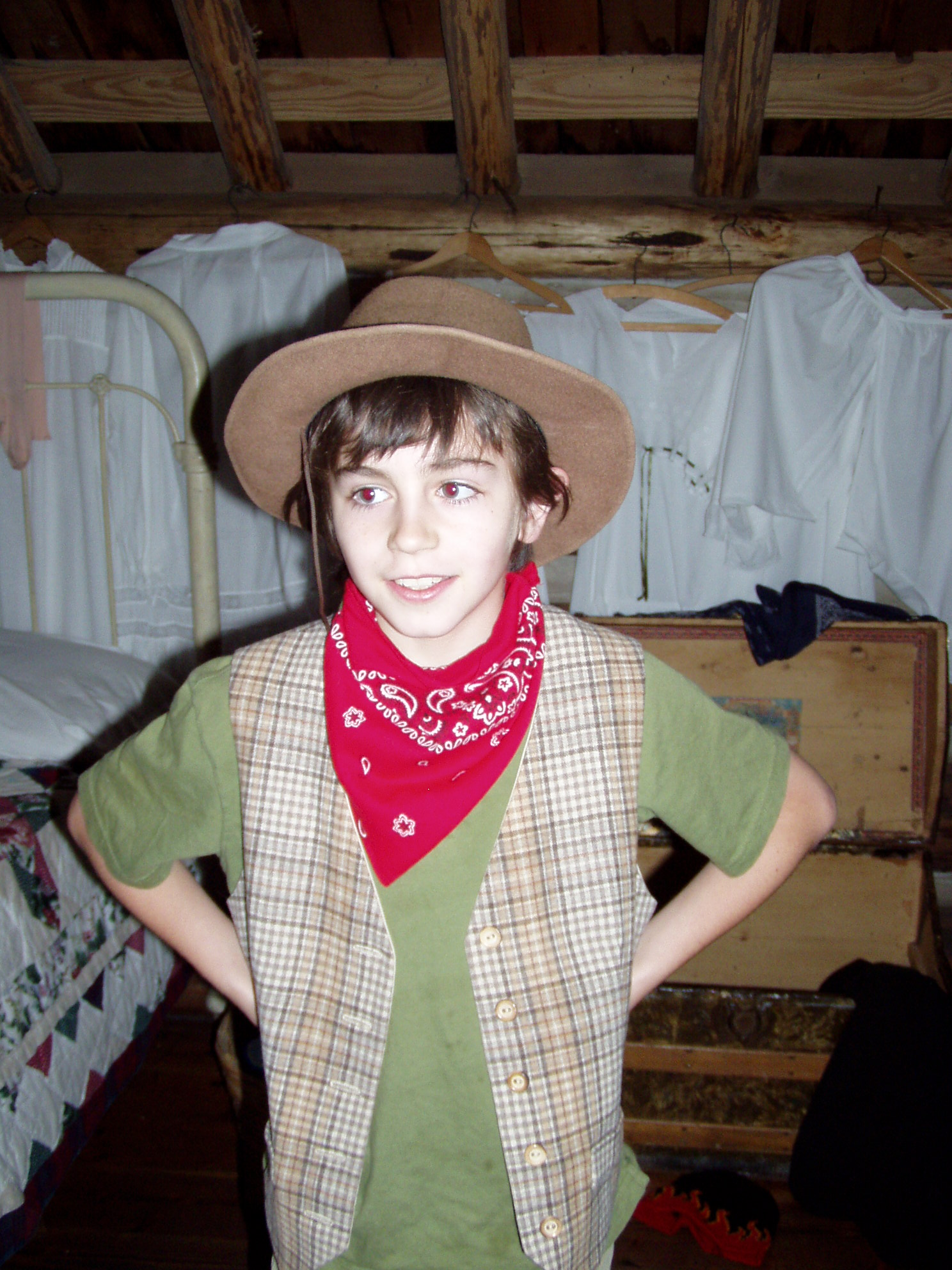 student in vest, cowboy hat and bandana