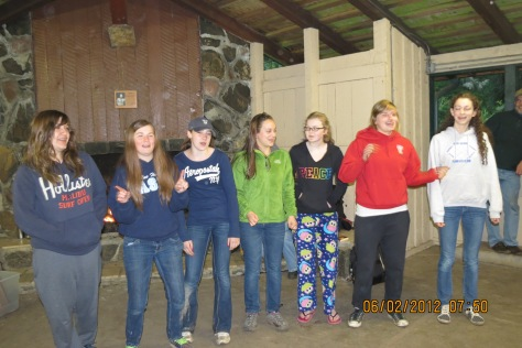 Seven 8th grade girls performing a song they made up.