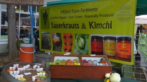 Farmer's Market stall with Midori Farms Sauerkrauts and Kimchi.