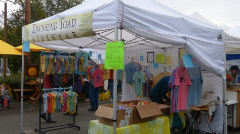 Farmer's Market Stand with kid's clothing.